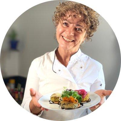 Laura the Chef serving three veggie burgers_Profile Picture