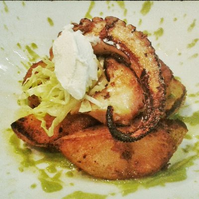 Lime grilled octopus on crunchy potatoes with rocket cream