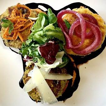 Three flavour mini veggyburger on a maroccan style humus with season salad